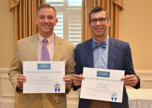 CAPTION: (LEFT TO RIGHT): Brian Felder, AIA, managing principal of Felder & Associates, and John O. Morisano, owner of The Grey, holding up their awards from the Historic Foundation Society