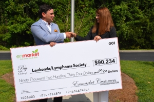 (LEFT to RIGHT) Houstoun Demere, Vice President of enmarket, presents check to Dana Stevens, Area Director of the Leukemia and Lymphoma Society handshake