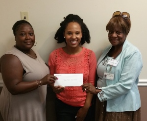 CAPTION: (LEFT TO RIGHT) DaShauna Kimble and Fran Wilson from Park Place Outreach Youth Emergency Shelter accept check from Jerrica Edmonds from International Paper