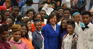 Dawn Baker poses for photos with Savannah High students